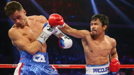 PAC Pacquiao wins lopsided decision to retain welterweight title belt